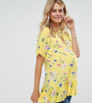 ASOS Maternity – T-shirt avec ourlet volanté asymétrique – Jaune