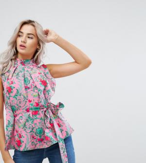 ASOS PETITE – Top à encolure montante et motif floral avec oeillets et lien à nouer à la t ...
