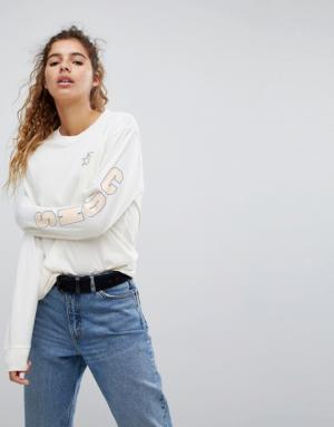 Converse – Cons – T-shirt de skate à manches longues avec logo sur le bras – Crème