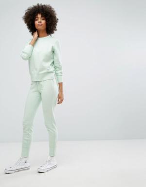 Converse – Essentials – Pantalon de jogging molletonné de première qualité – Vert