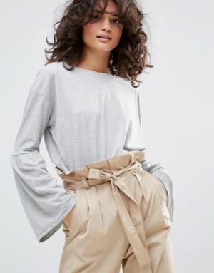 Vero Moda – Top manches longues avec ourlet style péplum – Gris